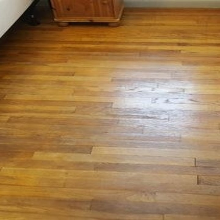 Same reviewer's picture of now shiny hardwood floor