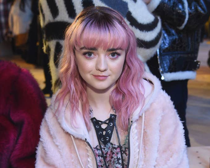 Maisie Williams front row at a fashion show.