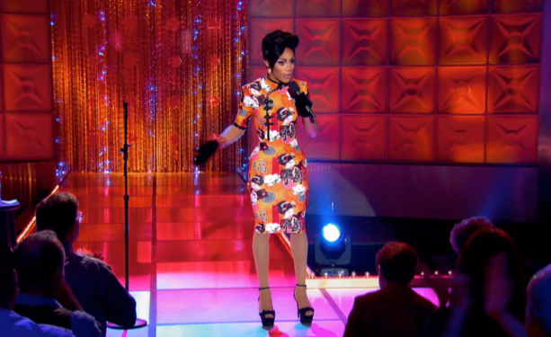 Trinity K. Bonet holds a mic during her stand-up comedy routine