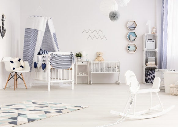 Bright nursery with geometric patterns and a canopy