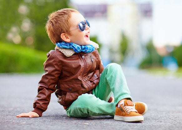 Little boy in a leather jacket, a scarf, and sunglasses
