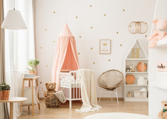 Bright nursery with polka dots and a canopy