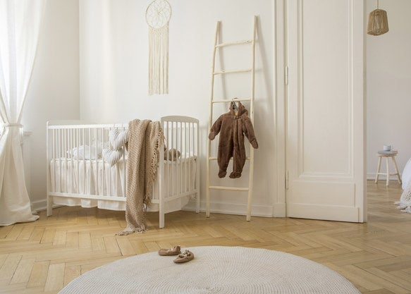Minimalist nursery with a lot of hardwood
