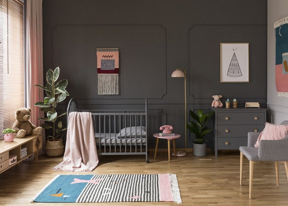 Modern nursery with lots of furniture and wall art