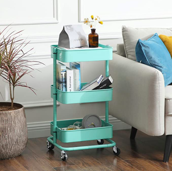 The 3-tier metal utility cart in a living room