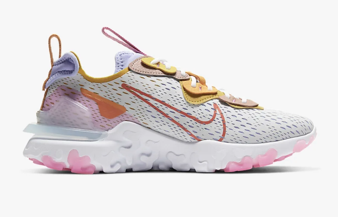Nike React Vision sneakers in pink, yellow, purple, and white