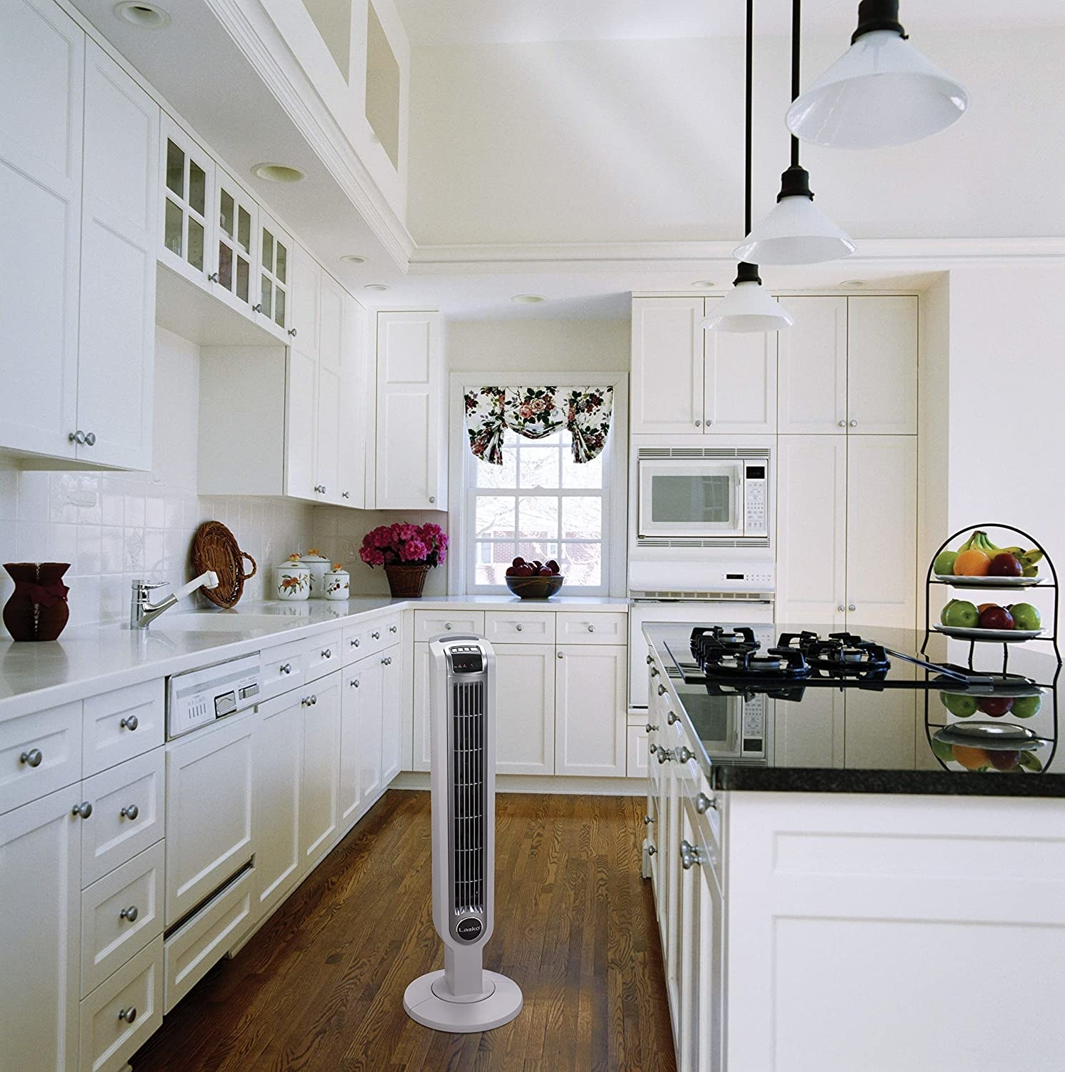 White oscillating tower fan placed in kitchen