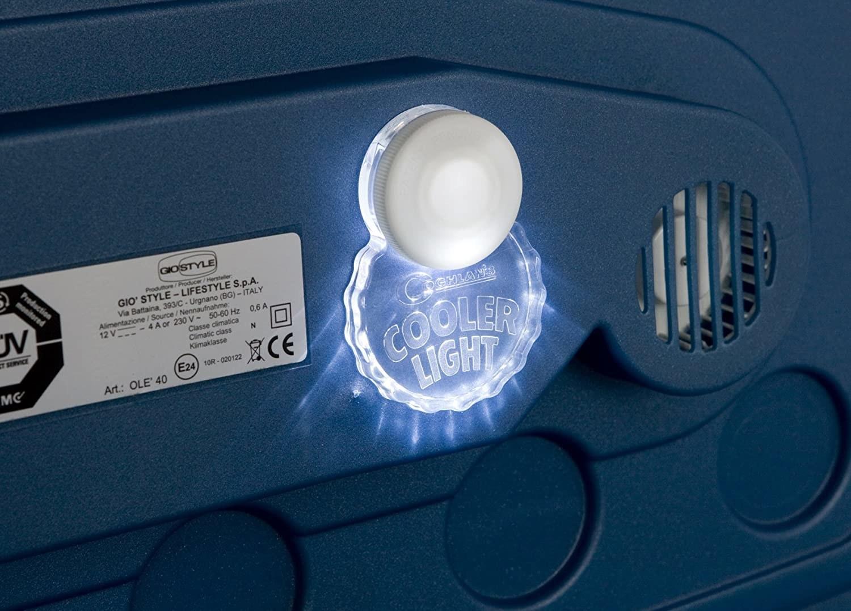 A lit-up cooler light on the lid of a cooler