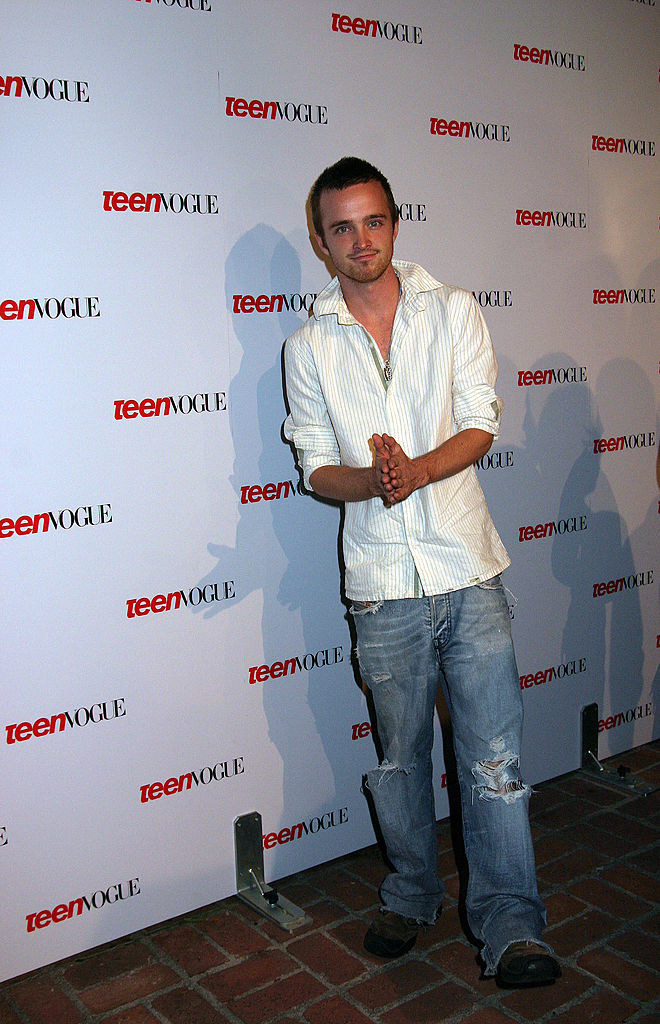 Aaron Paul on the red carpet for a Teen Vogue even wearing baggy distressed bootcut jeans and a stripped button down.