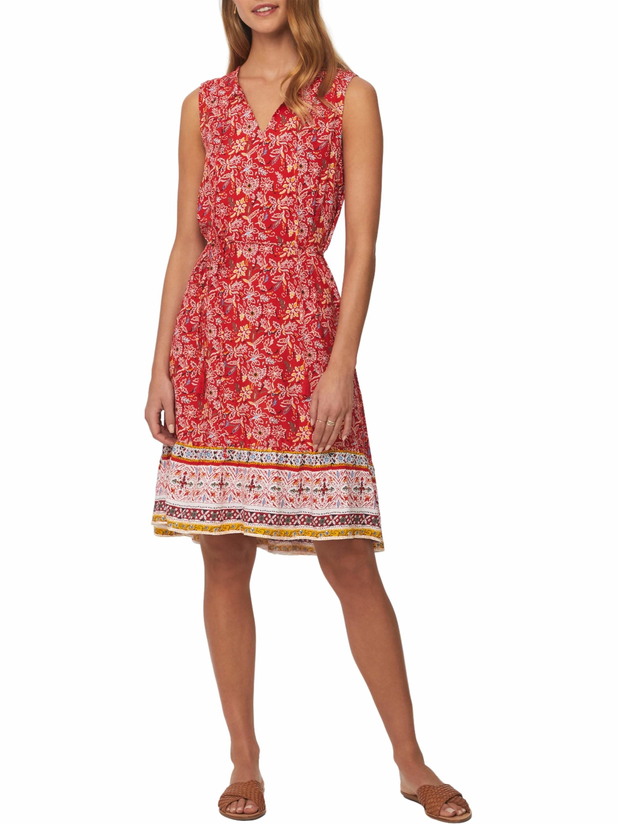 model in a sleevless paisley print dress with a v-neck
