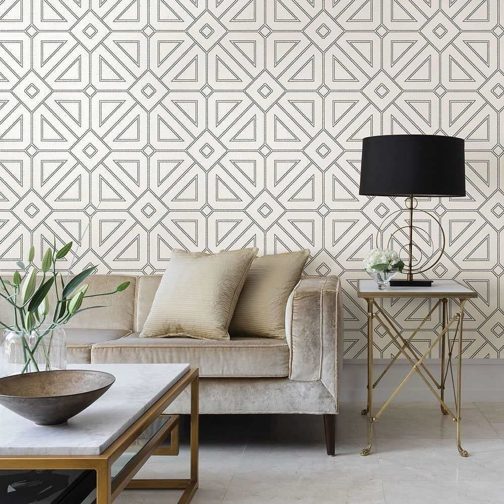 A geometric print wallpaper is used to create an accent wall