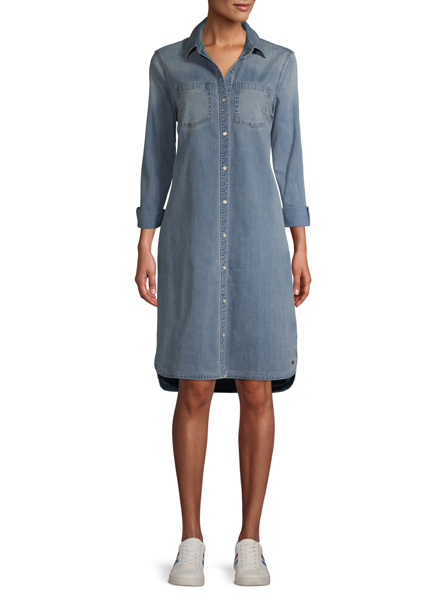 model in a denim button up dress with long sleeves