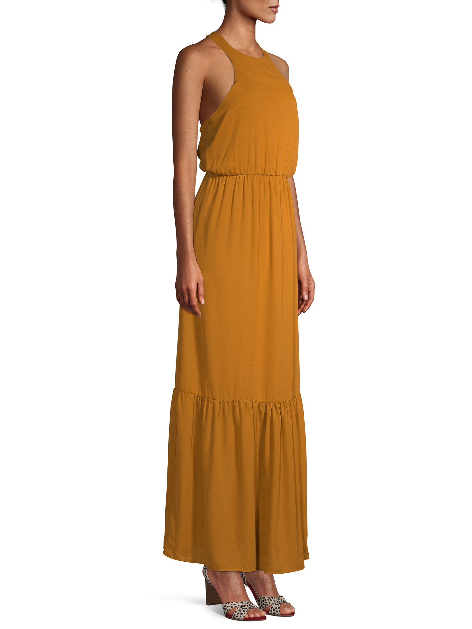 model in a yellow maxi halter dress