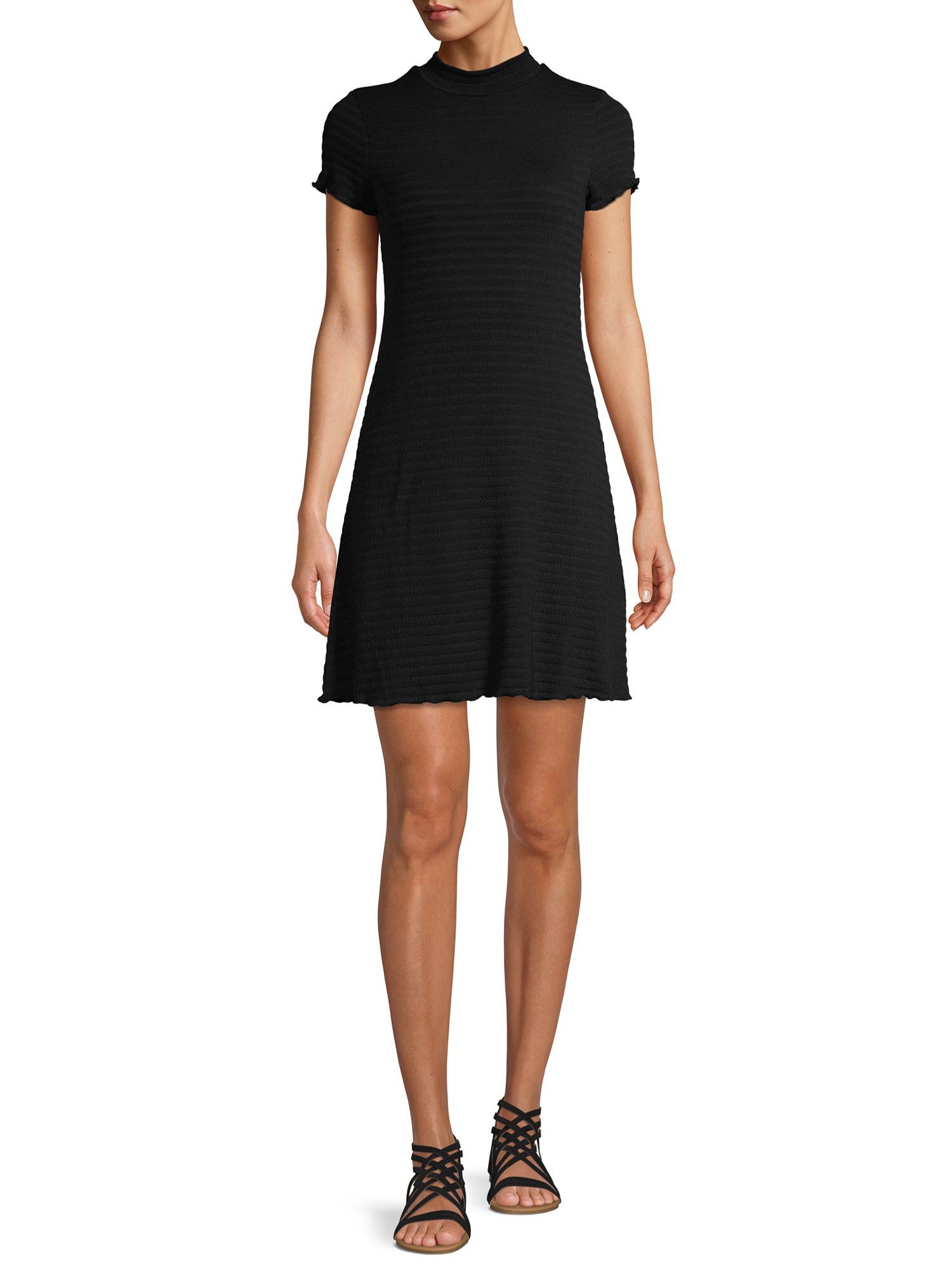 Model in a short sleeved black mock neck dress
