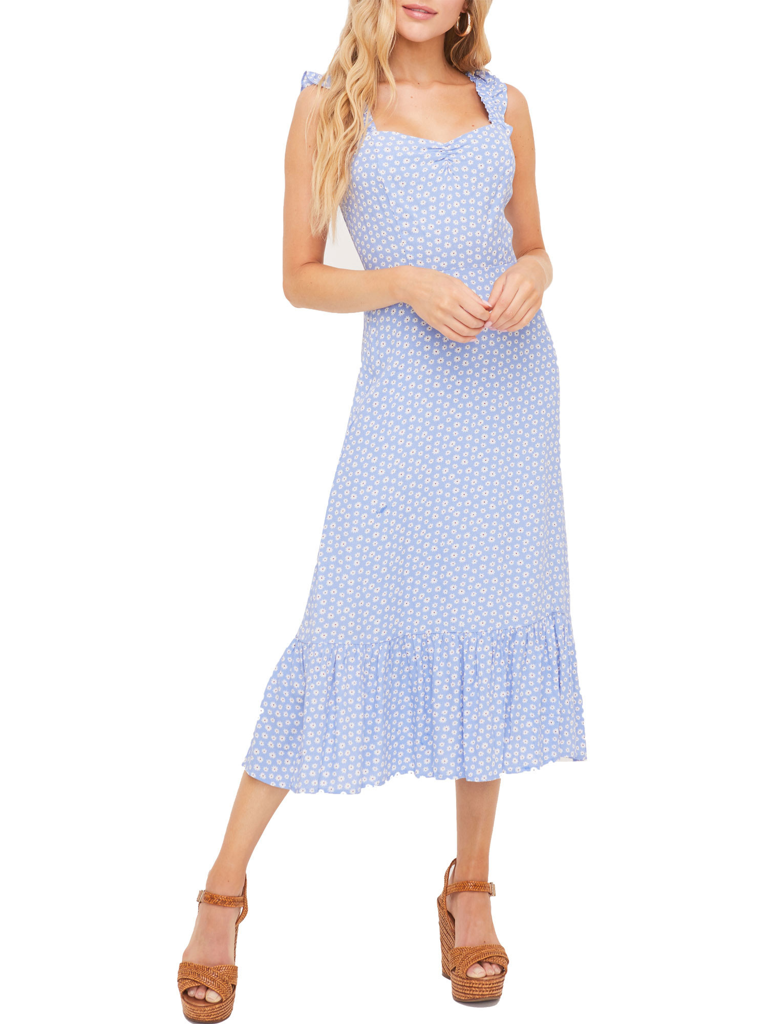 model in a dress with blue and white floral pattern