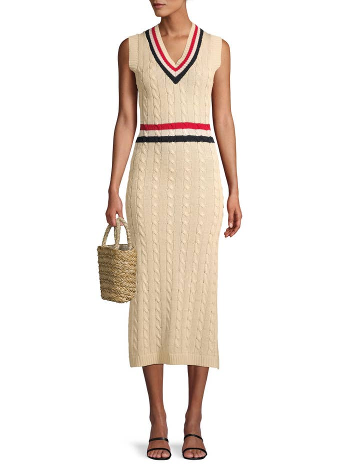 Model in a cable knit dress with red white and blue stripe at the waist and collar