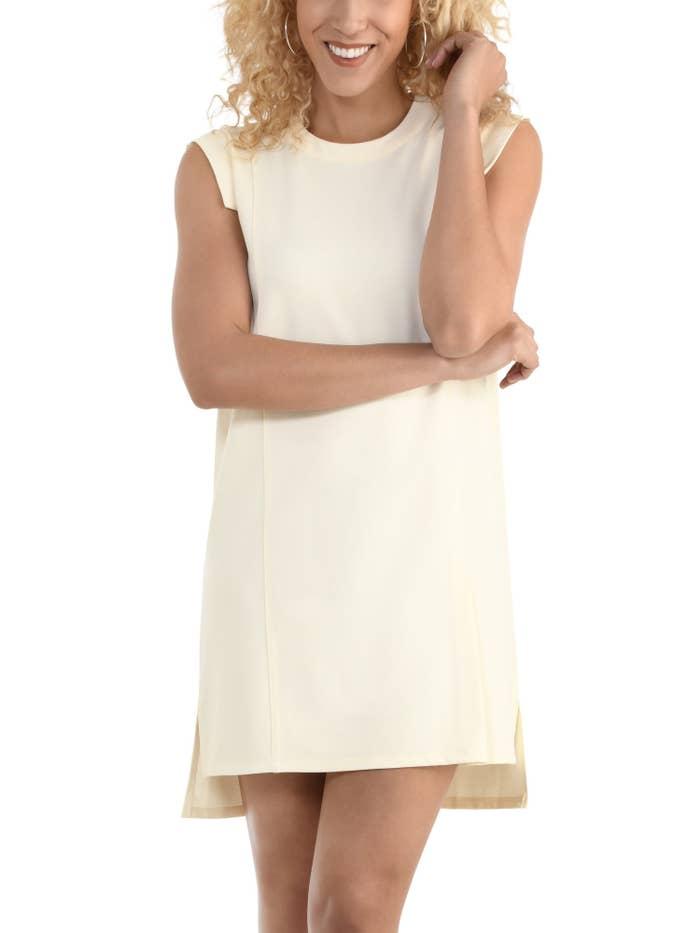 Model in an ivory pleated dress
