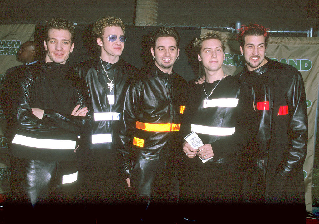 NSYNC wearing all leather outfits with reflective accents.