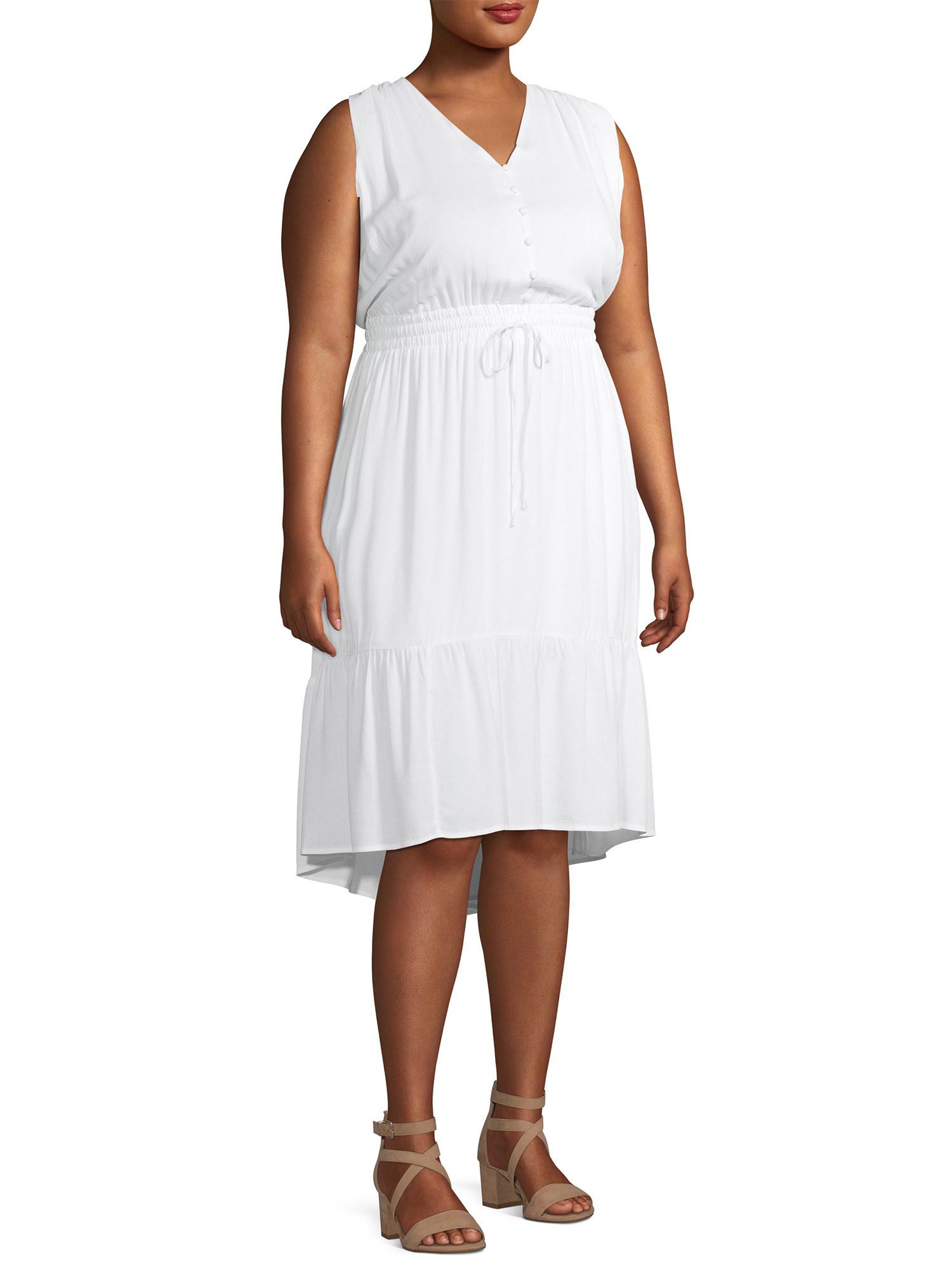model in a tie-front waist white dress
