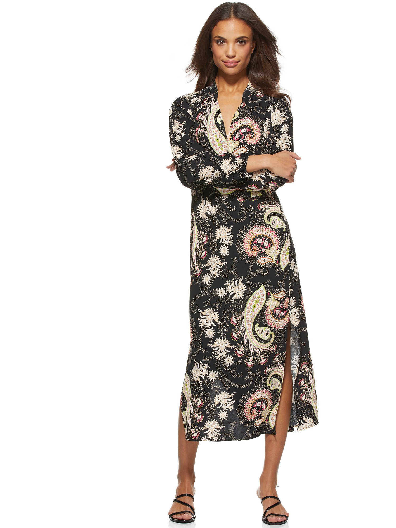 model in a black paisley midi dress with slits and long sleeves