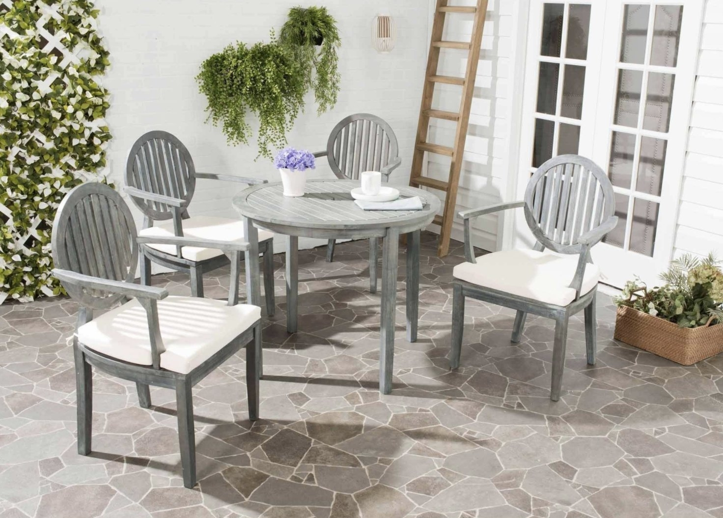 the dining set with grey wood and white seat cushions