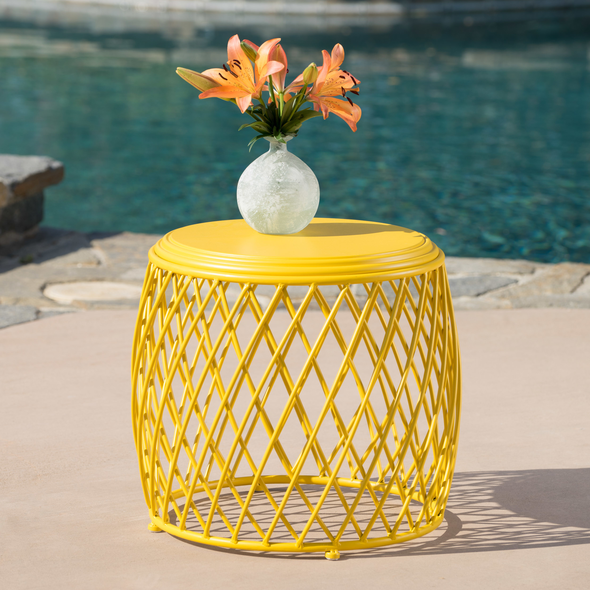 a yellow side table with a criss-crossed base