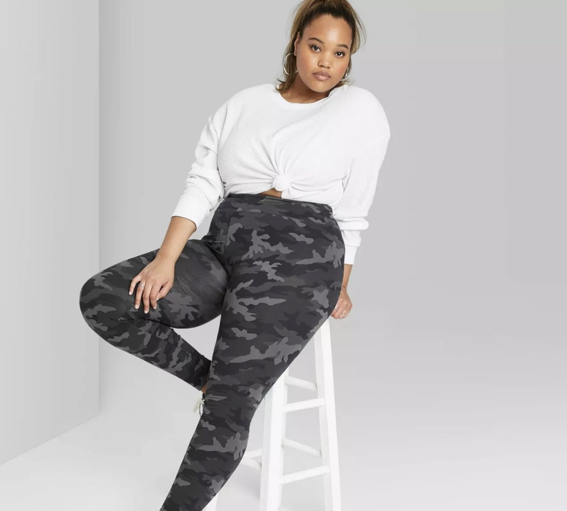 A model wearing gray camo print leggings