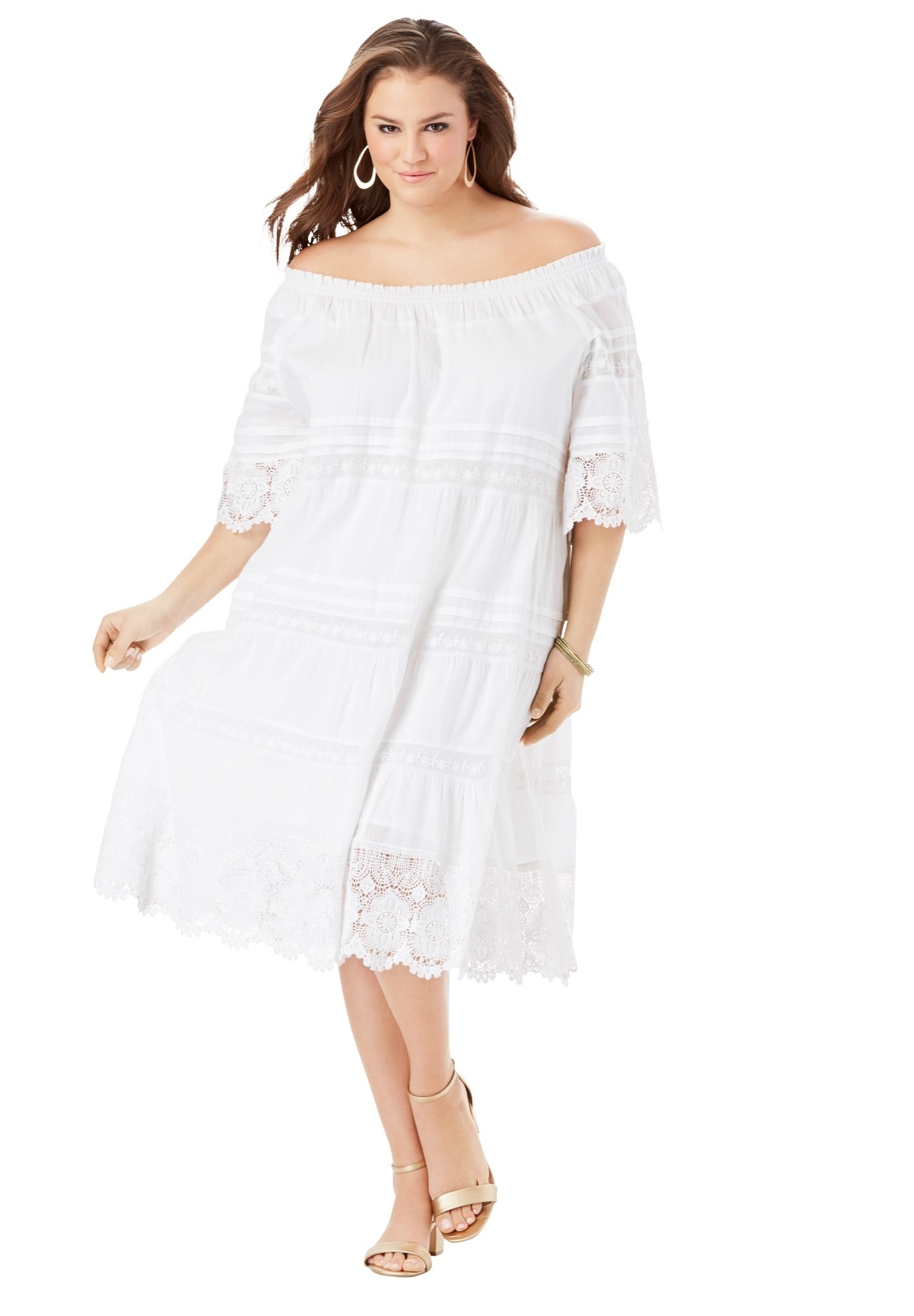 Model in an off the shoulder white lace dress