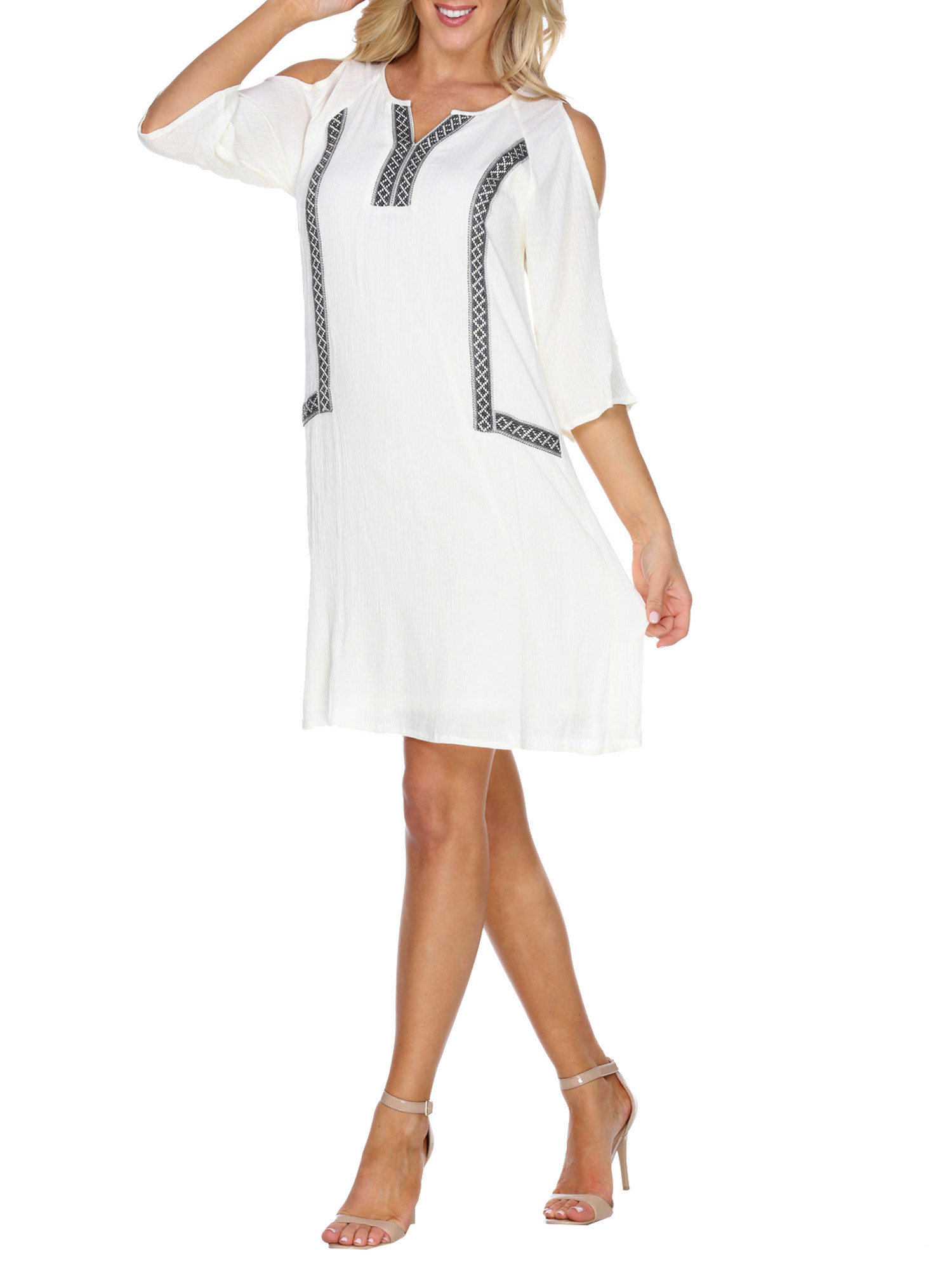 model in a white off the shoulder dress with black details