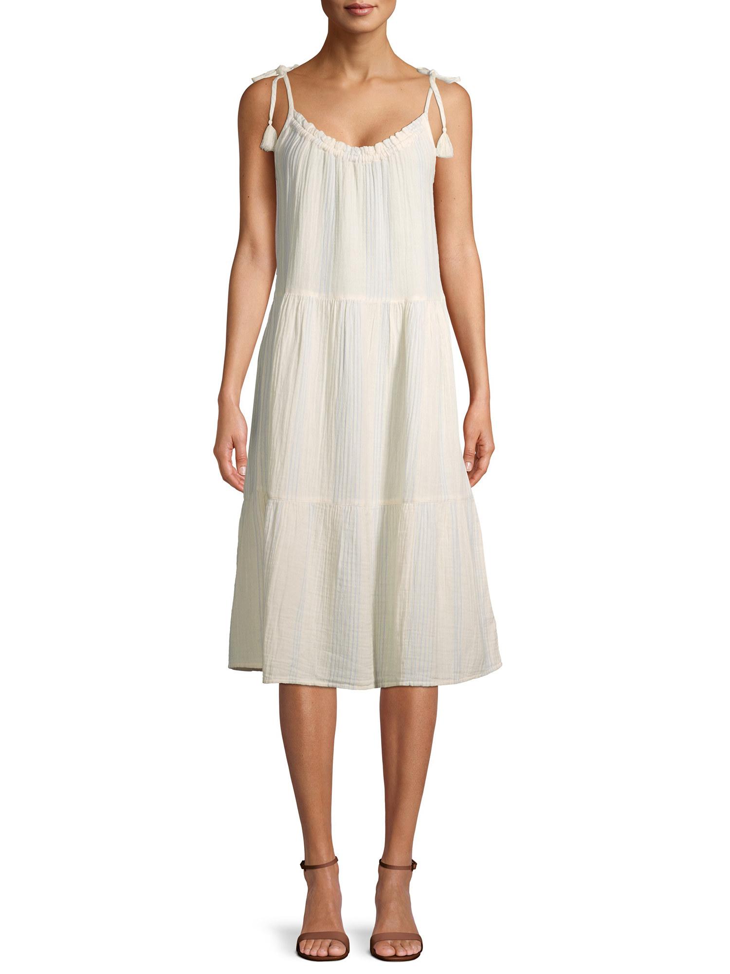 model in an ivory sleeveless midi dress