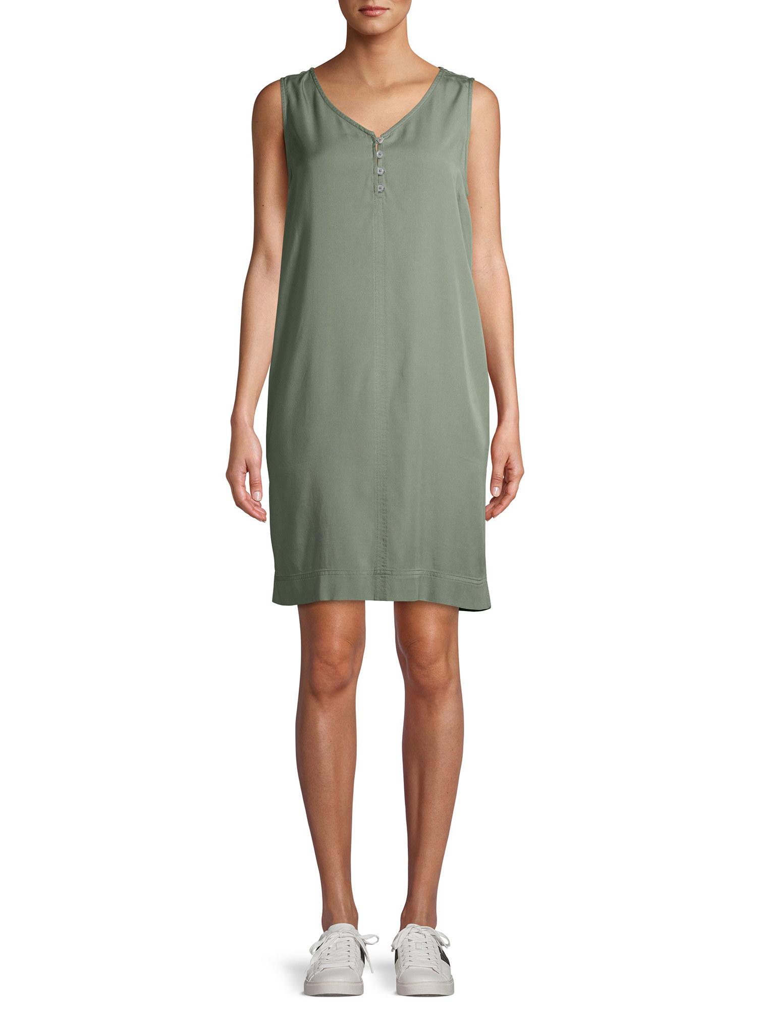 model in a green sleeveless v-neck dress