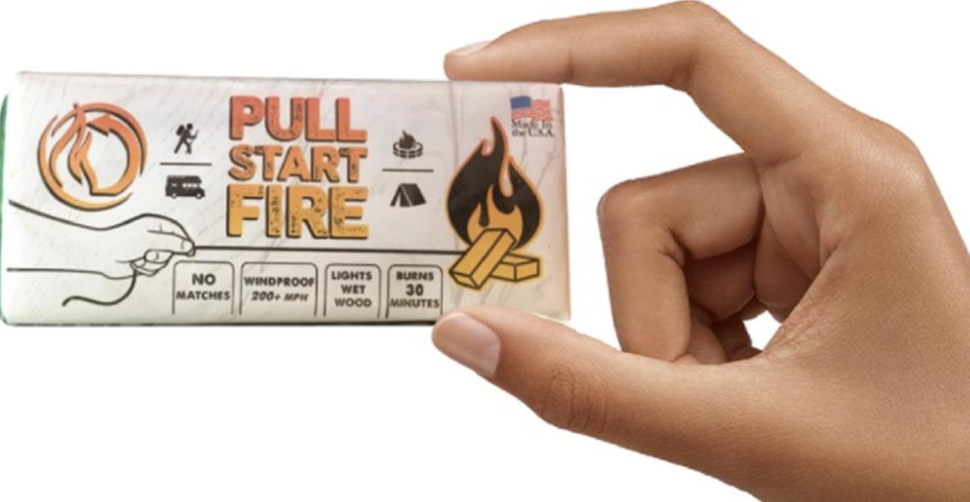 hand holding block-shaped fire starter
