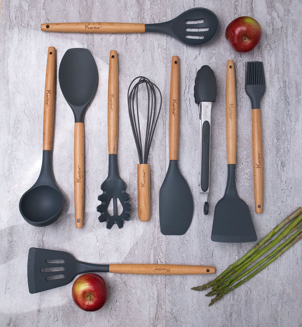 The set of 10 utensils with black silicone heads displayed on a table