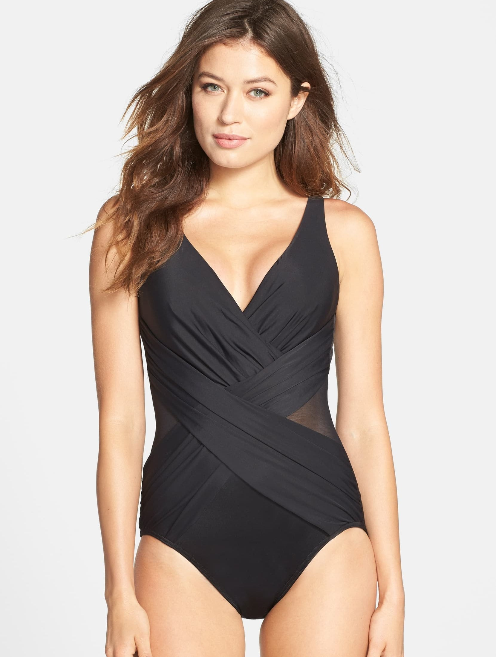 A person wearing the swimsuit in black