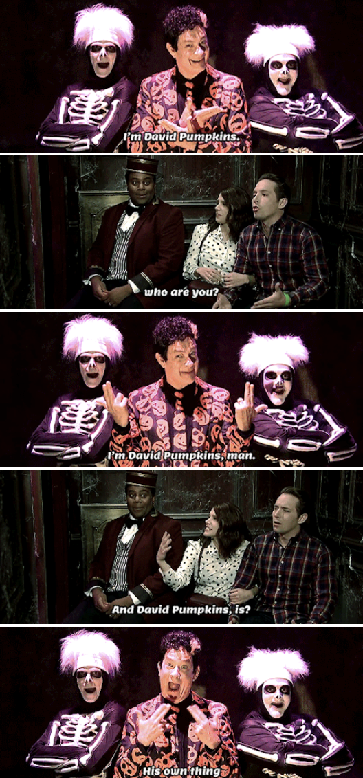 Tom Hanks as David S. Pumpkins, wearing a suit with pumpkins all over it, being hilariously spooky in a haunted elevator