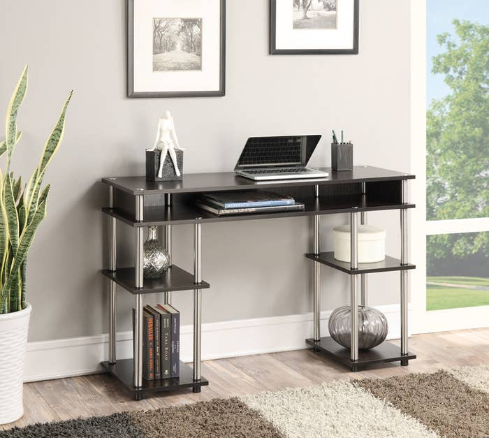 The black and silver desk with four open shelves
