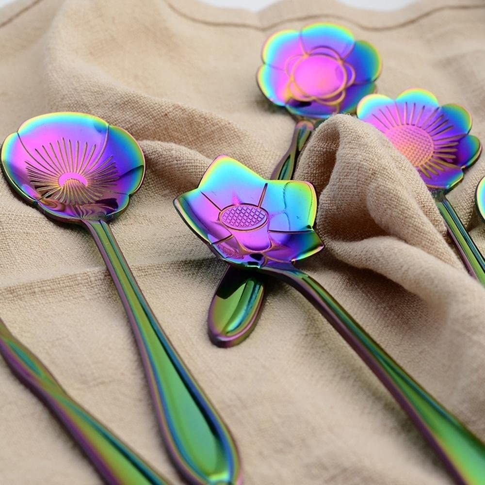 A set of spoons with flower heads in iridescent colors and green handles