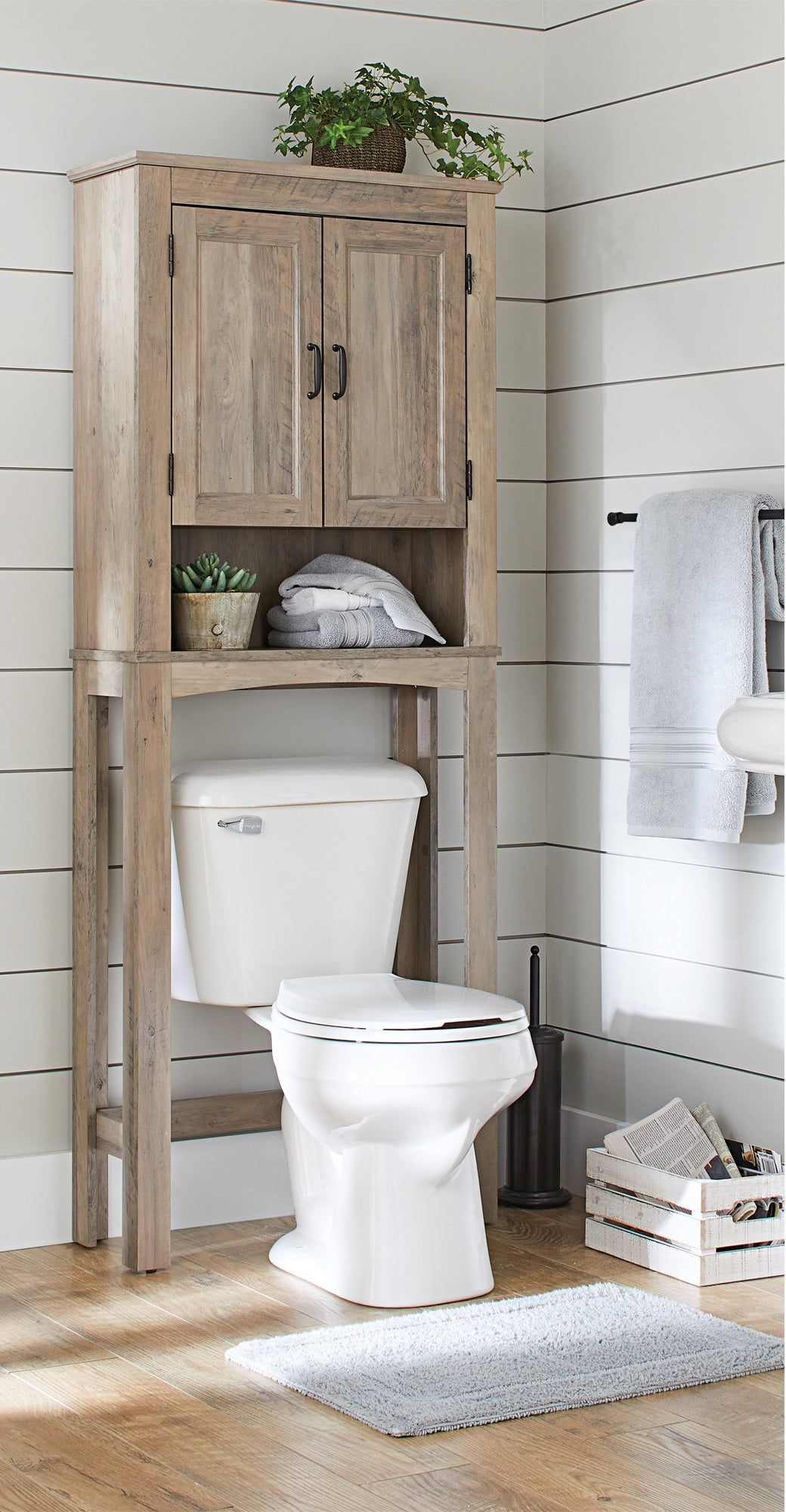 The light wooden standing bathroom shelving with cabinet doors