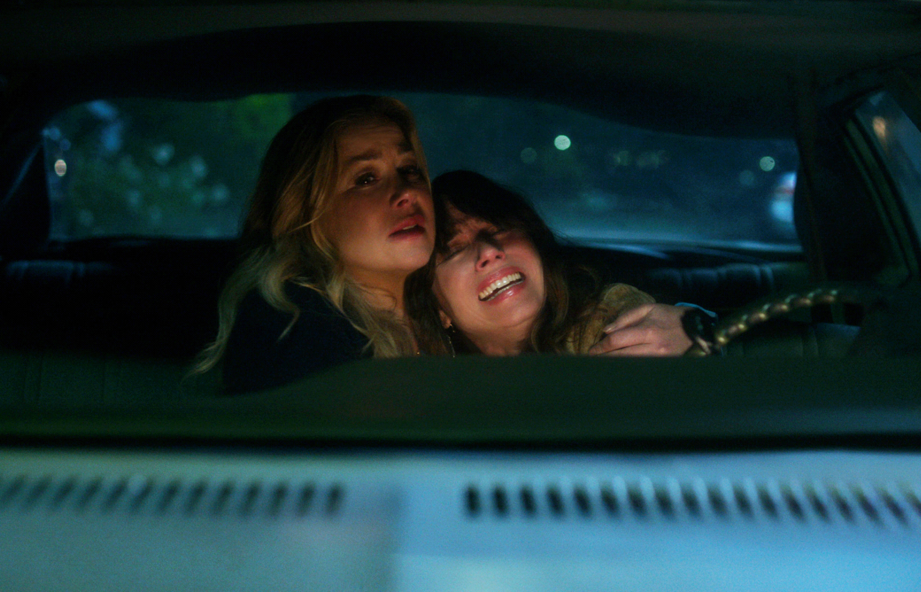 Christina Applegate and Linda Cardellini as Jen and Judy crying in a car in Dead to Me