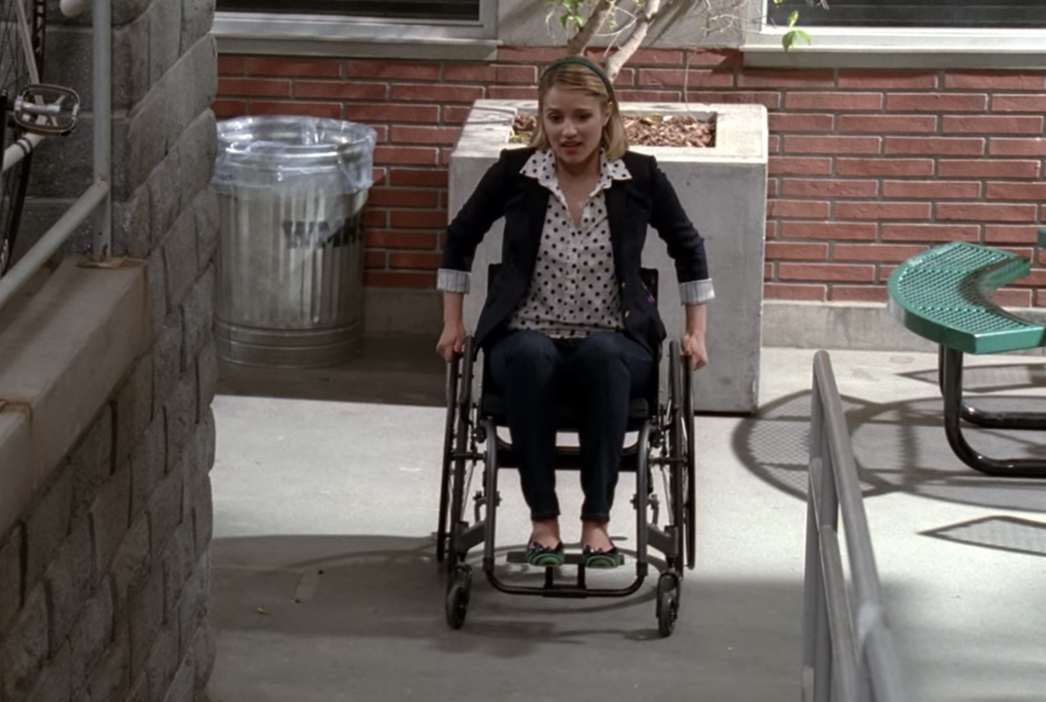 Quinn in a wheelchair going up a ramp
