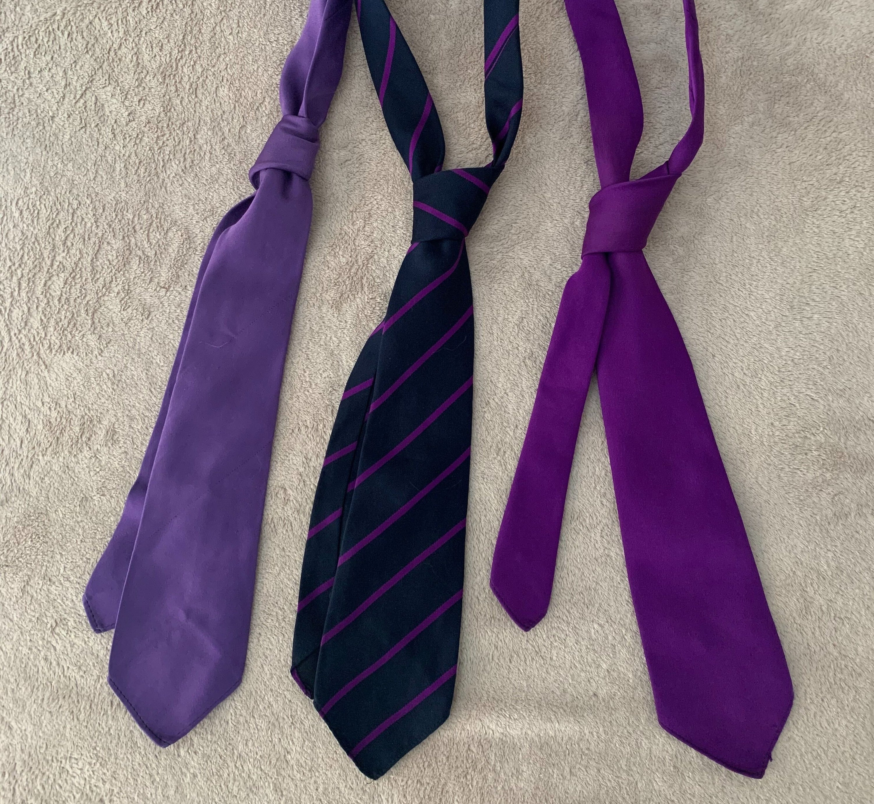 3 purple neck ties laid out