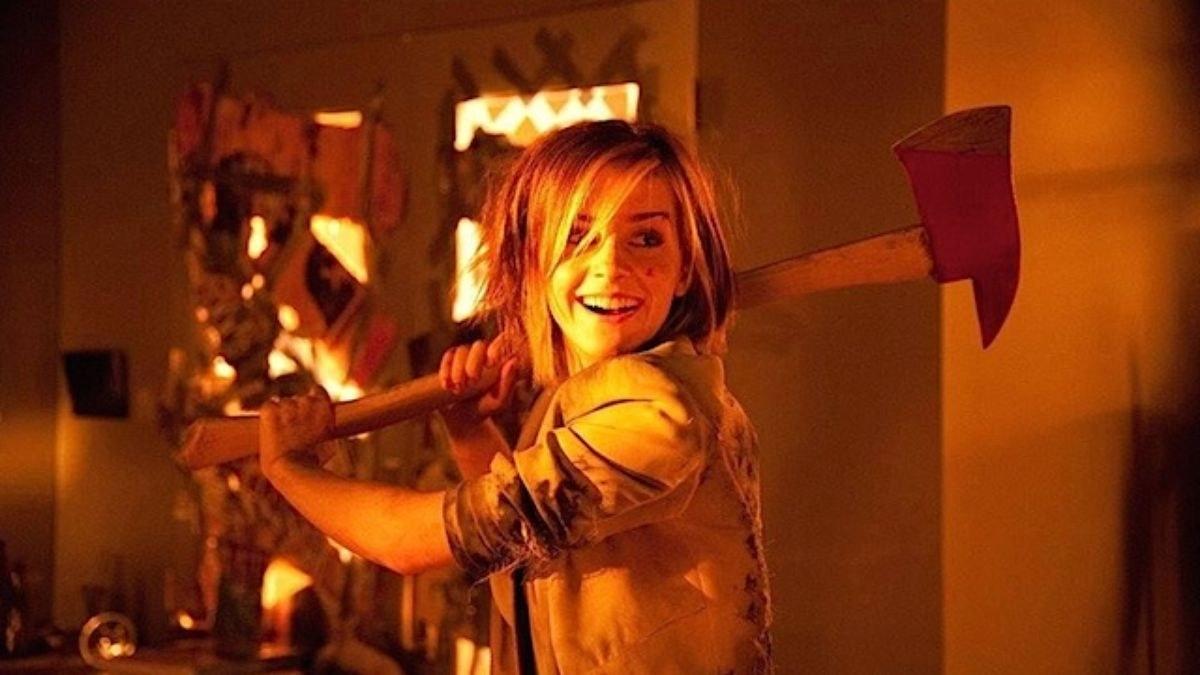 Emma Watson swings an axe