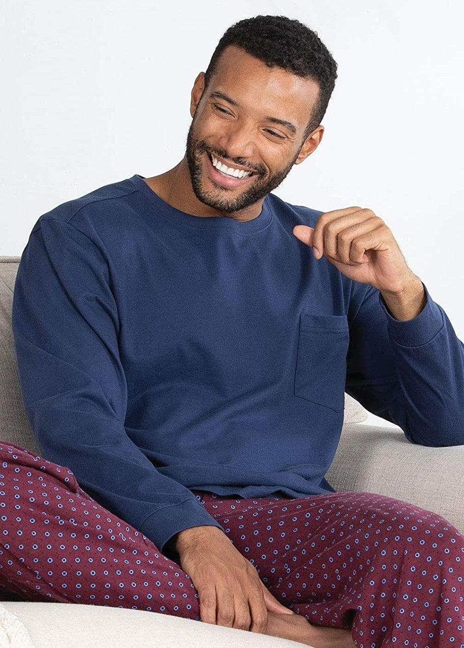 A person smiling in the pyjama set