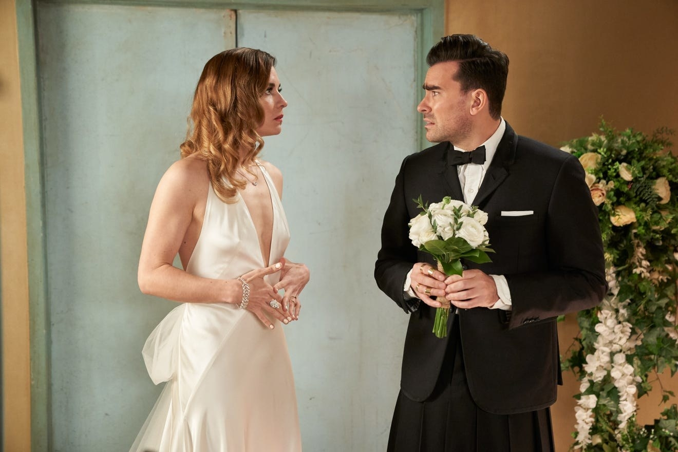 Annie Murphy and Dan Levy as Alexis and David in Schitt's Creek