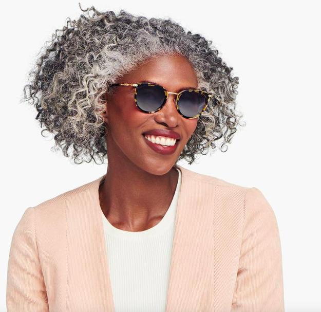 A woman wears the sunglasses