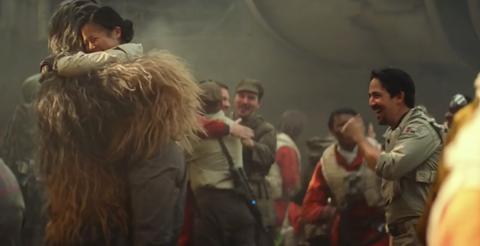 Lin-Manuel watches Chewbacca hug a fellow rebel