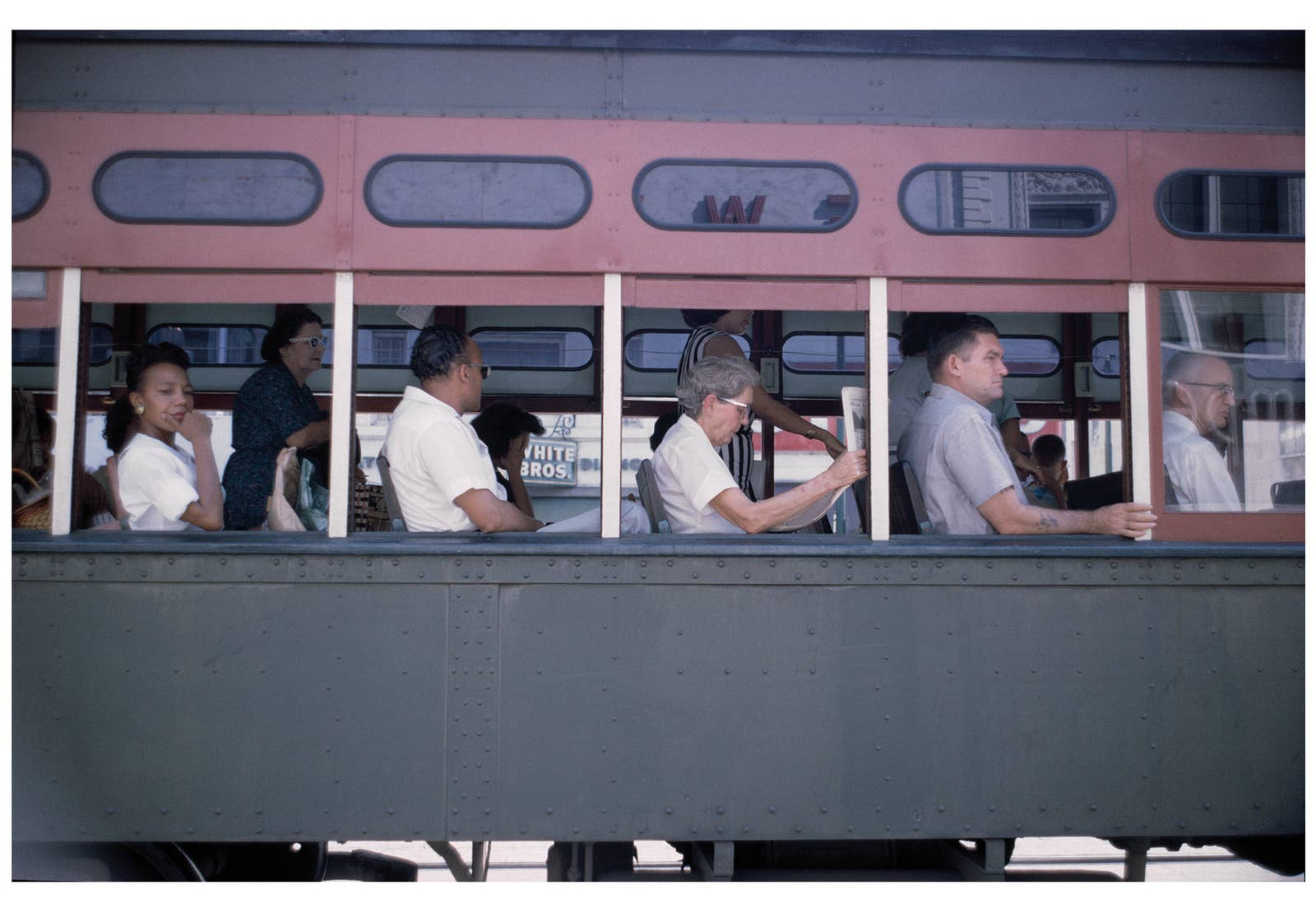 People sit on a city bus