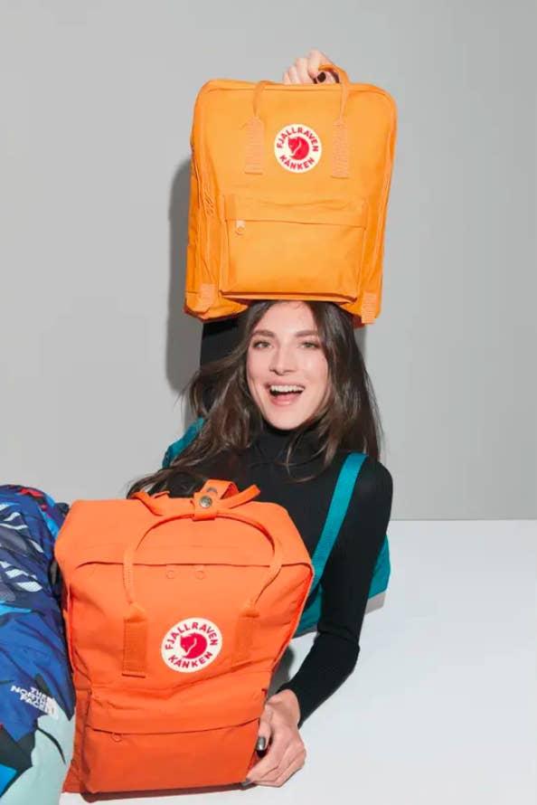 The light and dark orange backpacks