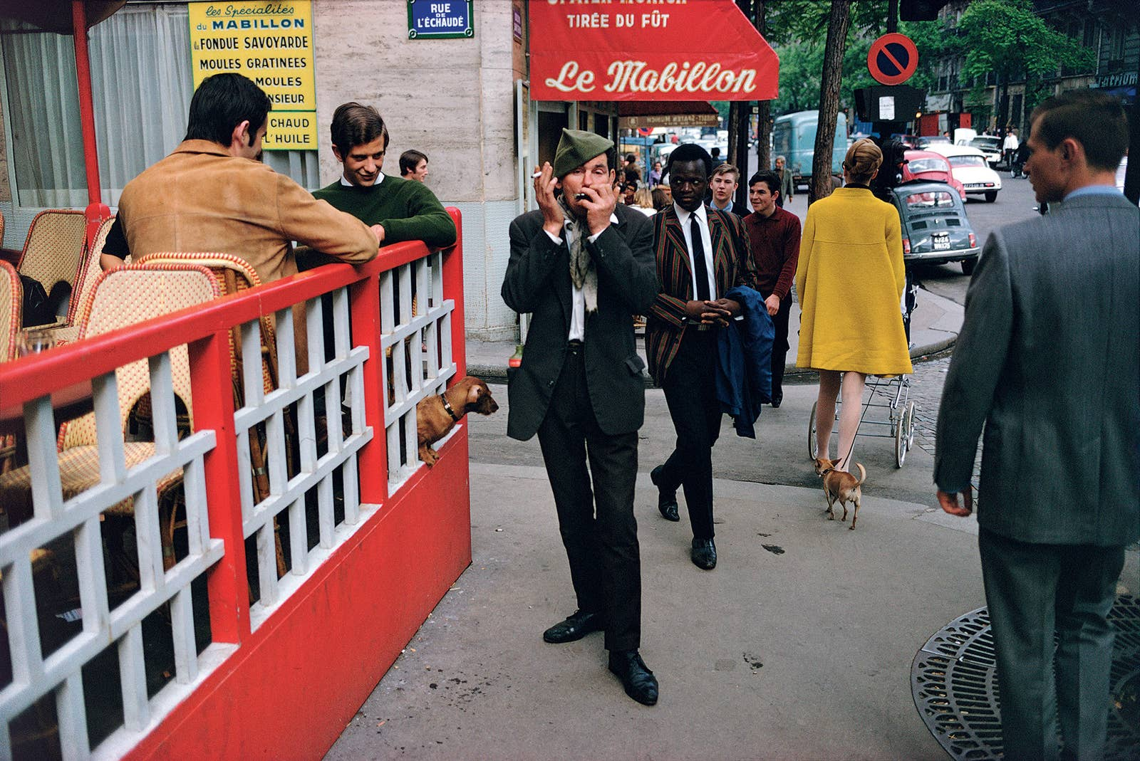 A man plays harmonica on a crowded city street