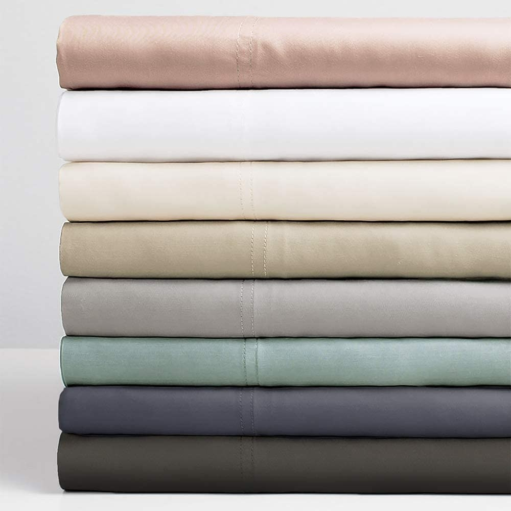 A stack of Cariloha Resort bamboo sheets in 10 different colors